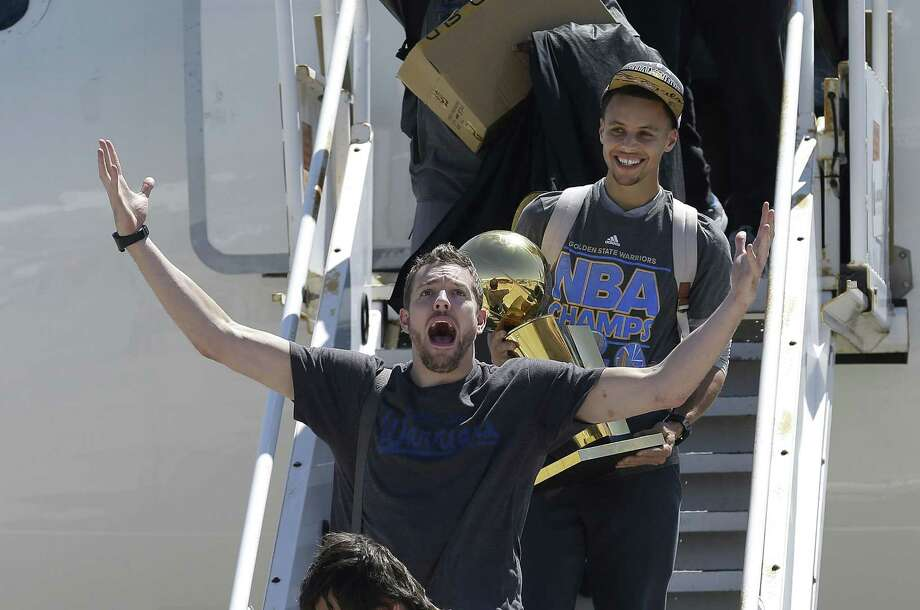 The Golden State Warriors traded David Lee, here with trophy-carrying Stephen Curry, to the Boston Celtics for Gerald Wallace. Photo: Jeff Chiu — The Associated Press File Photo   / AP