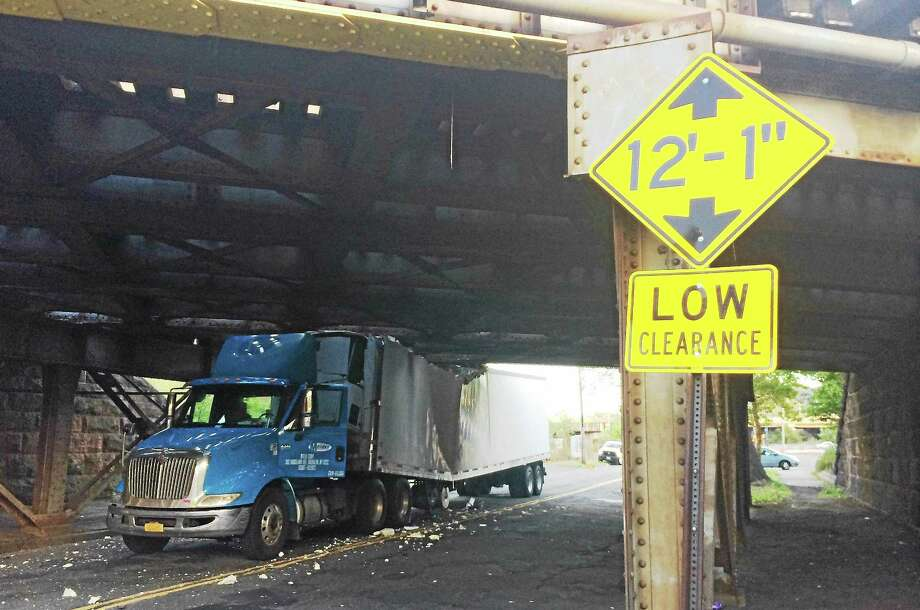 Part of James Street was closed for hours Wednesday morning after a tractor-trailer loaded with cooking oil and cheese slammed into a railroad bridge. Photo: Wes Duplantier — New Haven Register