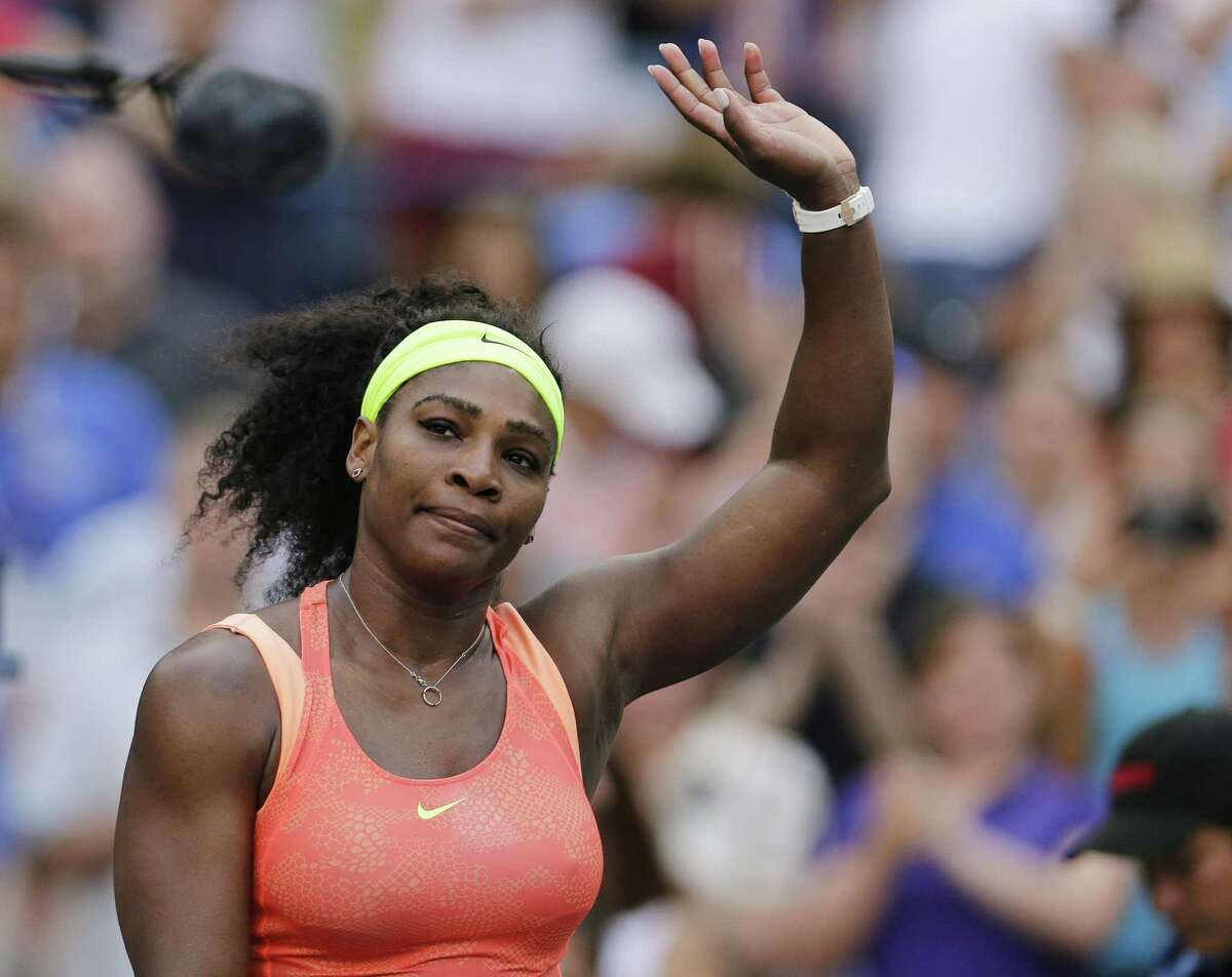 Serena Williams waves to fans after winning her match against Madison Keys on Sunday.
