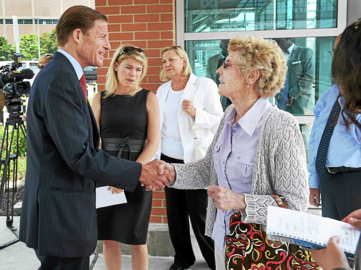 Annie Luden of East Haven, right, shakes hands with U.S. Senator Richard Blumenthal, with Acting Administrator of the Federal Railroad Administration Sarah Feinberg, second from left, and Luden's daughter Patricia Luden before the start of a press conference on July 6, 2015 at the West Haven Railroad Station. They addressed efforts to improve worker railroad worker safety. Luden's son, Robert E. Luden of East Haven , a railroad worker, was killed in a work-related accident nearby May 2013 and the press conference took place near a memorial to him.