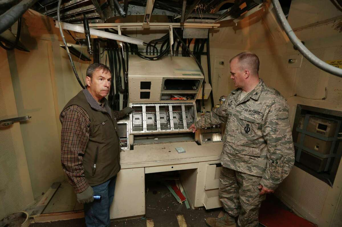 In this April 6, 2015, file photo, retired Air Force Col. Barry Kistler, left, and Col. Todd Sauls stand at a former control panel in the underground launch control center at the Air Force's Quebec-01 Missile Alert Facility north of Cheyenne, Wyo. The Air Force has been restoring the missile alert facility as a state historic site.