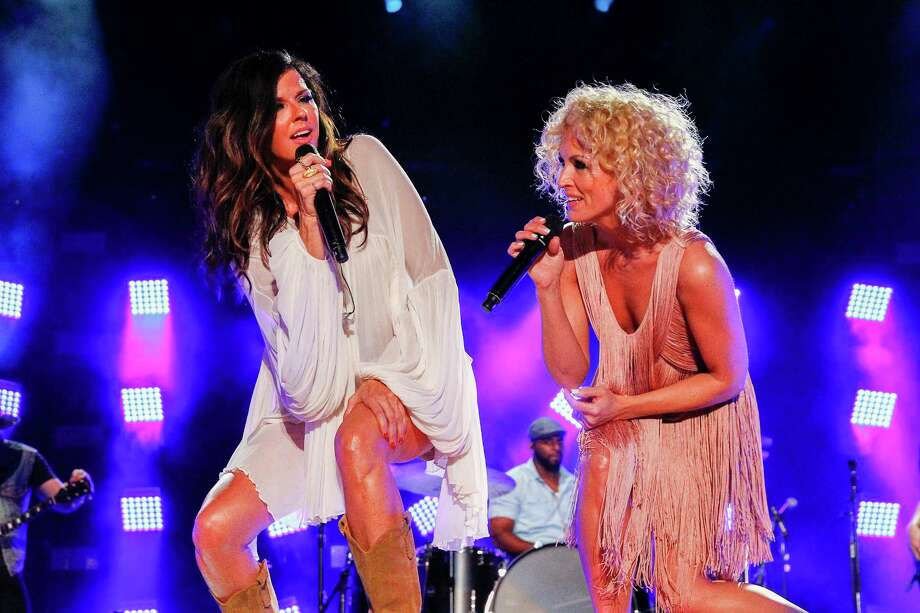 In this June 13, 2015 photo, Karen Fairchild, left, and Kimberly Schlapman, right, of Little Big Town performs at LP Field at the CMA Music Festival, in Nashville, Tenn. Photo: Photo By Al Wagner/Invision/AP, File   / Invision
