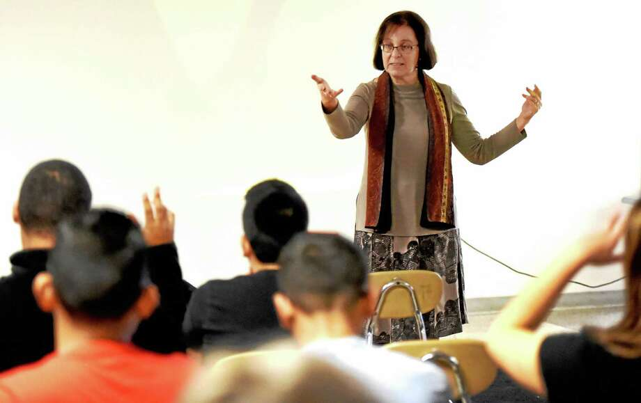 """Doris Zelinsky, executive producer of the documentary, """"People Forget ... New Haven Remembers,"""" answers questions from High School in the Community students during an assembly Friday in New Haven. Photo: Peter Hvizdak — New Haven Register   / ©2015 Peter Hvizdak"""