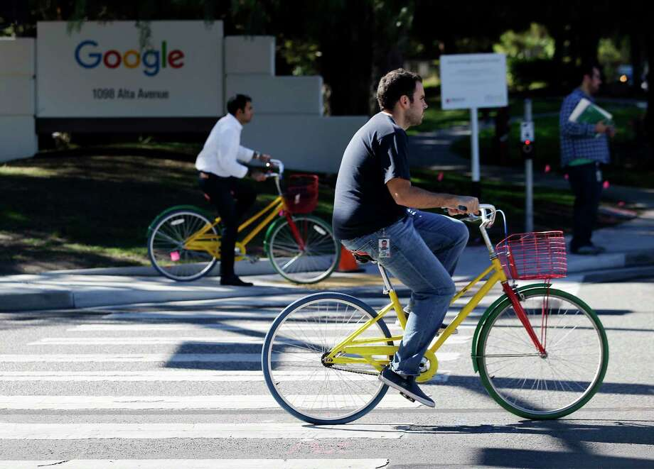 Employees ride company bicycles outside Google headquarters in Mountain View, Calif. Photo: AP Photo/Marcio Jose Sanchez   / AP