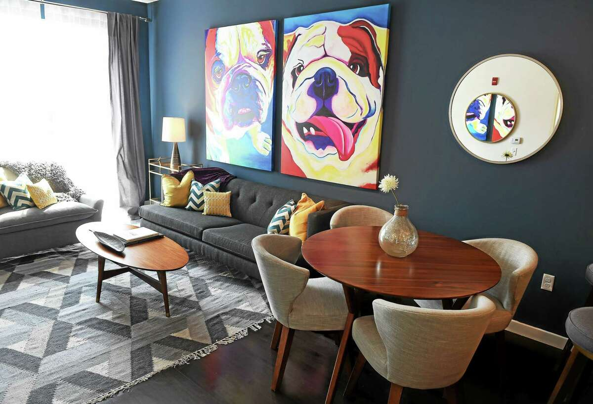 (Arnold Gold-New Haven Register) A living room/dining room area of a one bedroom apartment at The Novella in New Haven.
