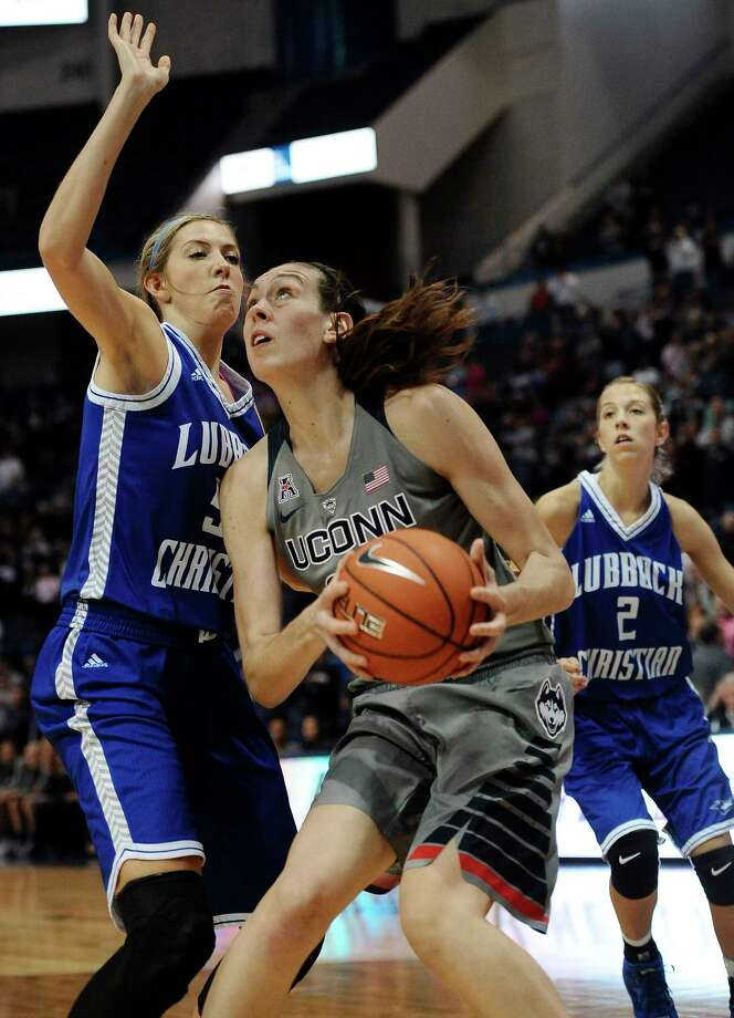 UConn's Breanna Stewart, right, shoots against Lubbock Christian's Tess Bruffey during the first half of an exhibition game Monday night in Hartford. Photo: Jessica Hill — The Associated Press   / AP2015