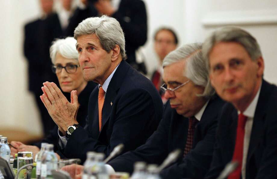 U.S. Secretary of State John Kerry meets with foreign ministers of Germany, France, China, Britain, Russia and the European Union at a hotel in Vienna, Austria, Tuesday, July 7, 2015. Iran nuclear talks were in danger of busting through their second deadline in a week Tuesday, raising questions about the ability of world powers to cut off all Iranian pathways to a bomb through diplomacy, and testing the resolve of U.S. negotiators to walk away from the negotiation as they've threatened. (Carlos Barria/Pool photo via AP) Photo: Ap / reuters pool