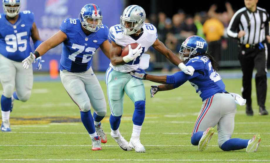 The Dallas Cowboys released running back Joseph Randle on Tuesday. Photo: Bill Kostroun — The Associated Press   / FR51951 AP