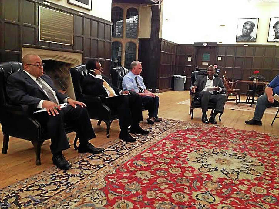 Board of Education candidates, from left, Darnell Goldson, Edward Joyner and Jim O'Connell answer questions at an Alpha Phi Alpha forum led by moderator Brian Perkins, at right. Photo: Brian Zahn — New Haven Register