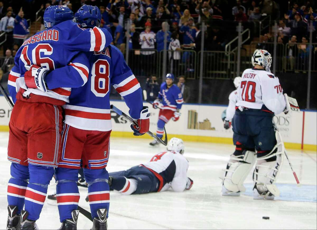 New York Rangers' Kevin Klein (8) celebrates his goal with teammate Derick Brassard (16) as Washington Capitals' Alex Ovechkin (8) and goalie Braden Holtby (70) look away during the second period of an NHL hockey game Tuesday, Nov. 3, 2015, in New York. (AP Photo/Frank Franklin II)