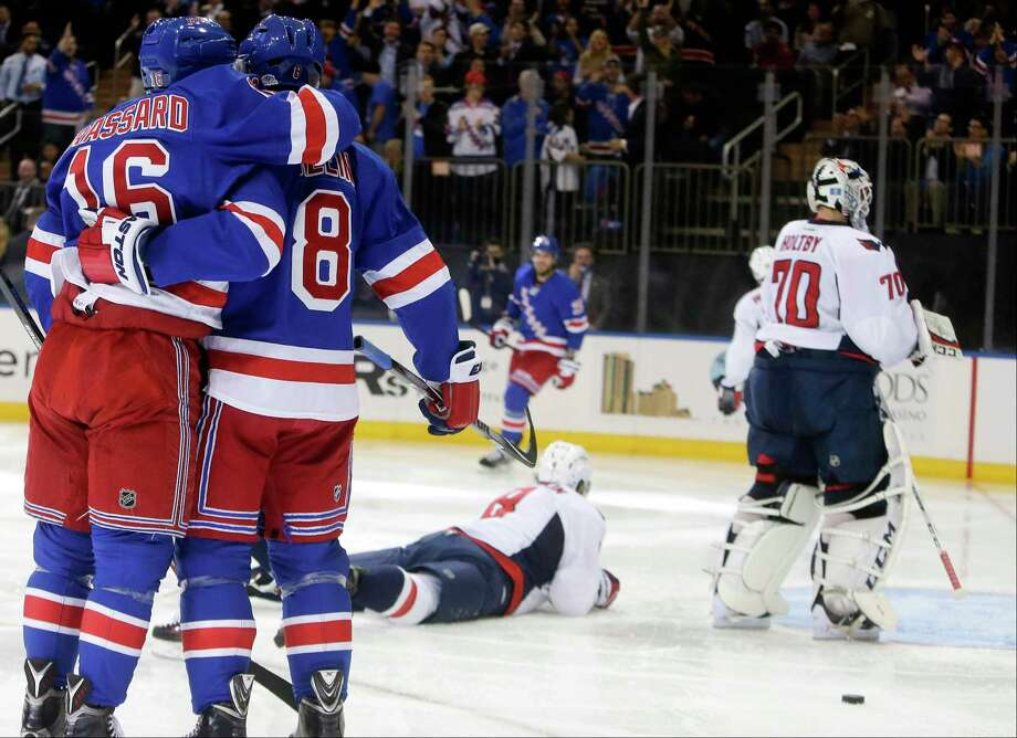 New York Rangers' Kevin Klein (8) celebrates his goal with teammate Derick Brassard (16) as Washington Capitals' Alex Ovechkin (8) and goalie Braden Holtby (70) look away during the second period of an NHL hockey game Tuesday, Nov. 3, 2015, in New York. (AP Photo/Frank Franklin II) Photo: AP / AP