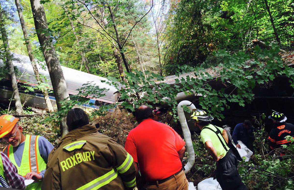 First responders assess the scene of an Amtrak passenger train derailment Monday, Oct. 5, 2015, in Northfield, Vt. The train, the Vermonter, was headed from Vermont to Washington, D.C., when it apparently struck rocks that were on the tracks. No life-threatening injuries were reported.