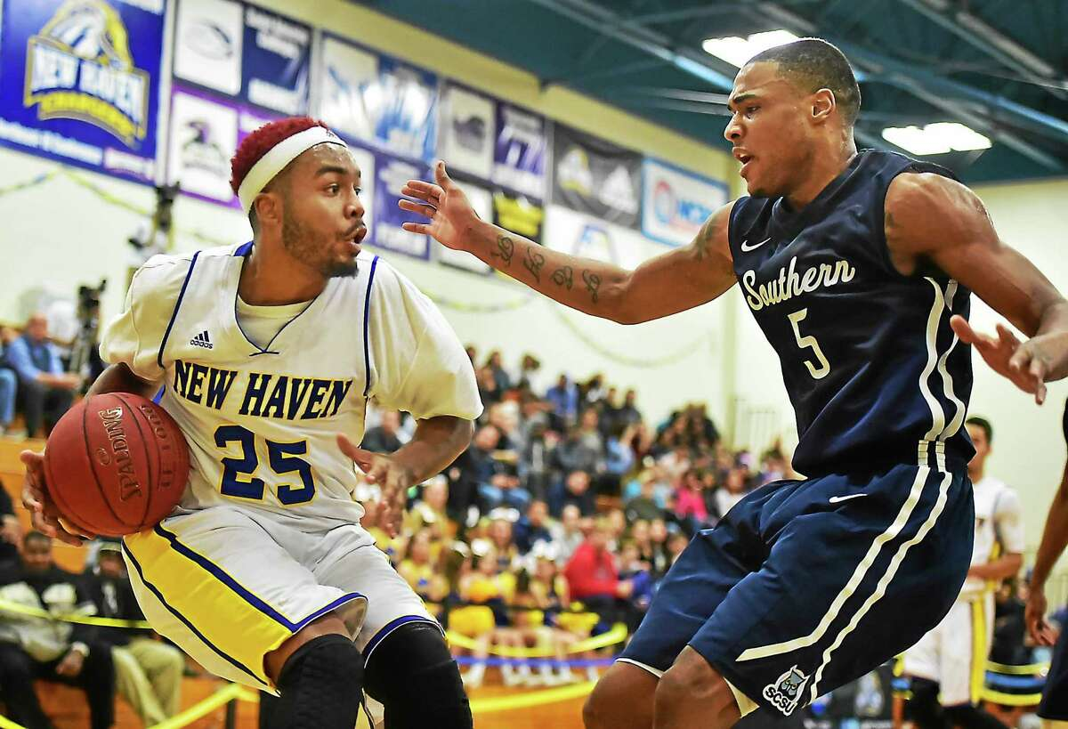 Catherine Avalone - New Haven Register New Haven sophomore guard Levy Gillespie makes a move on Southern junior forward Eric Ross Wednesday.