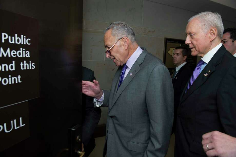 In this July 22, 2015, file photo, Sens. Charles Schumer, D-N.Y., left, and Orrin Hatch, R-Utah., arrive for a classified briefing by Secretary of State John Kerry on Iran, on Capitol Hill in Washington. Schumer is breaking with President Barack Obama and will oppose the Iran nuclear deal. Photo: AP Photo/Cliff Owen, File / FR170079 AP