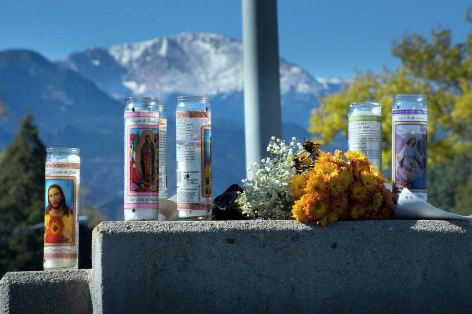 Pikes Peak forms a backdrop o Nov. 2, 2015 for a memorial to the victims of Saturday's shootings in downtown Colorado Springs, Colo. Photo: Mark Reis/The Gazette Via AP   / The Gazette
