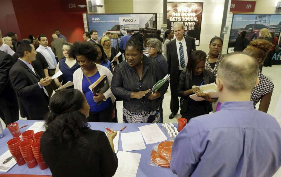 In this photo taken Wednesday, June 10, 2015, job seekers attend a job fair in Sunrise, Fla. The Labor Department reports on the number of people who applied for unemployment benefits the week ending Aug. 1 on Thursday, Aug. 6, 2015. (AP Photo/Alan Diaz) Photo: AP / AP