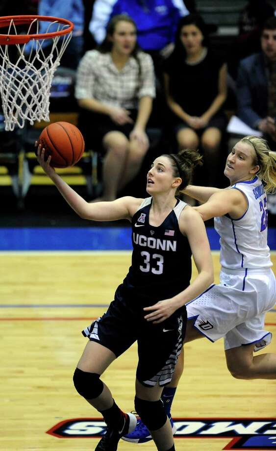 UConn freshman Katie Lou Samuelson goes up for a shot against DePaul's Brooke Schulte during the fourth quarter of the Huskies' 86-70 win Wednesday in Chicago. Photo: Paul Beaty — The Associated Press   / FR36811