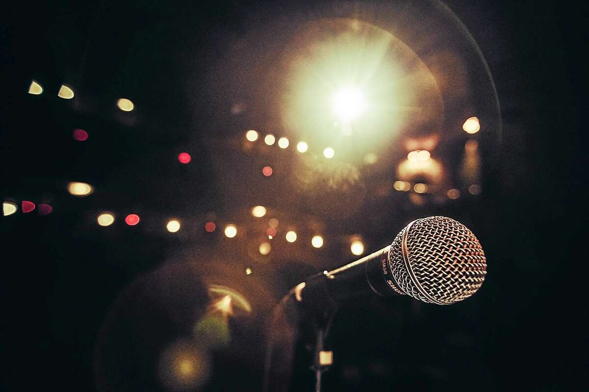 Storytellers look out into the bright light and spin their entertaining as well as thought-proking yarns during The Moth.