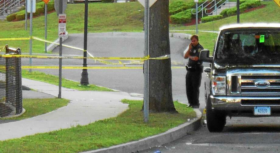 Bouchet Lane in eastern New Haven was blocked off Thursday morning as police investigated the fatal shooting of a city man there Wednesday night. Police are asking for the public to help them find out more about what happened. Photo: Wes Duplantier — New Haven Register
