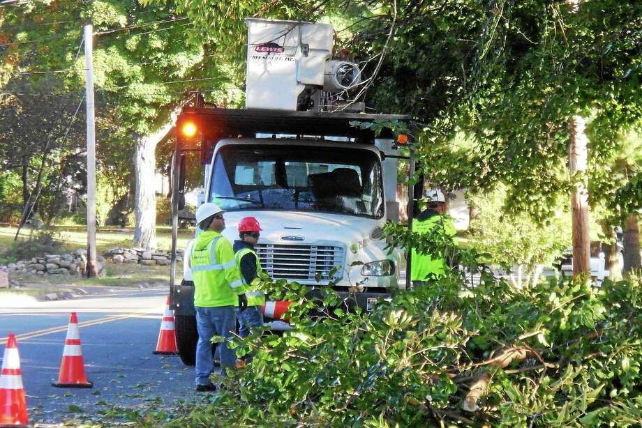 Classes at West Haven High School started 90 minutes late Tuesday after tree branches fell onto power lines on Platt Avenue. Tree crews were at the scene near Cove Street, cleaning up the branches around 8:30 a.m. Photo: Wes Duplantier -- New Haven Register