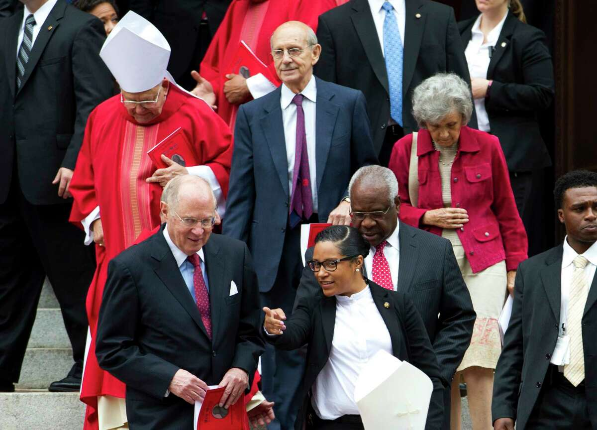 U.S. Supreme Court Justices Anthony M. Kennedy, left, Stephen Breyer, center, and Clarence Thomas, leave St. Mathews Cathedral, after the Red Mass in Washington on Oct. 4, 2015. The Supreme Court's new term starts Monday, Oct. 5.