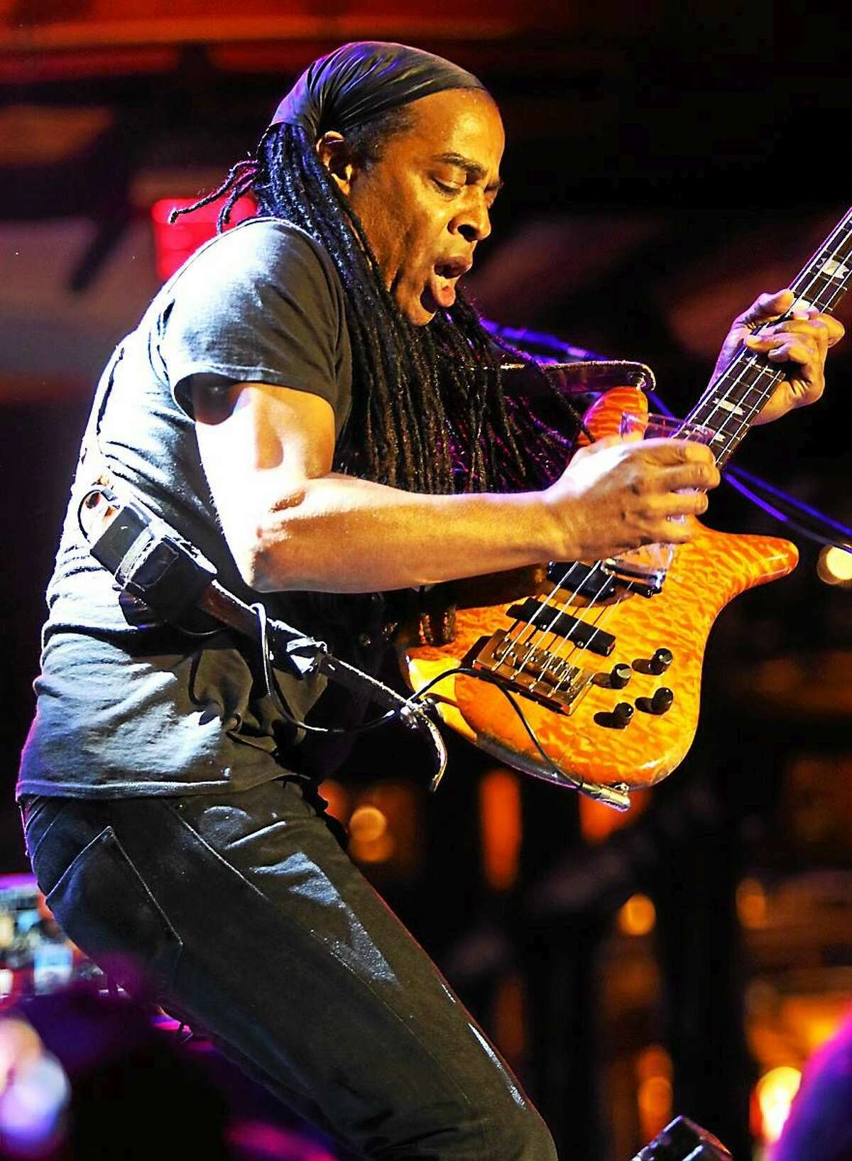Photo by John Atashian Living Colour bassist Doug Wimbish, a Bloomfield native, is shown soloing on stage at the Wolf Den Lounge during the bands concert performance at the Mohegan Sun Casino in Uncasville on Friday July 3. The hard rock band from New York City are on a U.S. tour in support of their brand new CD, ìShade.î