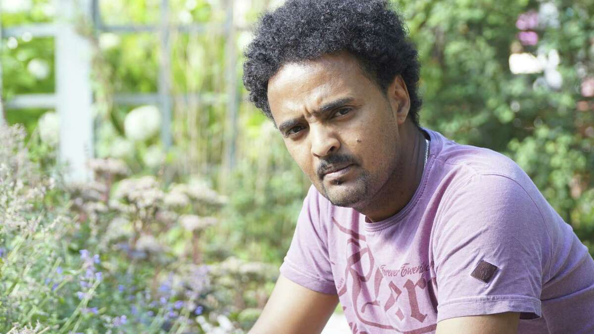 Eritrean refugee Adal Neguse poses for a photograph on Aug. 21, 2015, in Stockholm, Sweden, who has now gained Swedish citizenship. Adal's brother died in the Oct. 3, 2013, tragedy in Lampedusa, Italy and faced long delays in having the death of his brother officially confirmed and told the place of his burial.