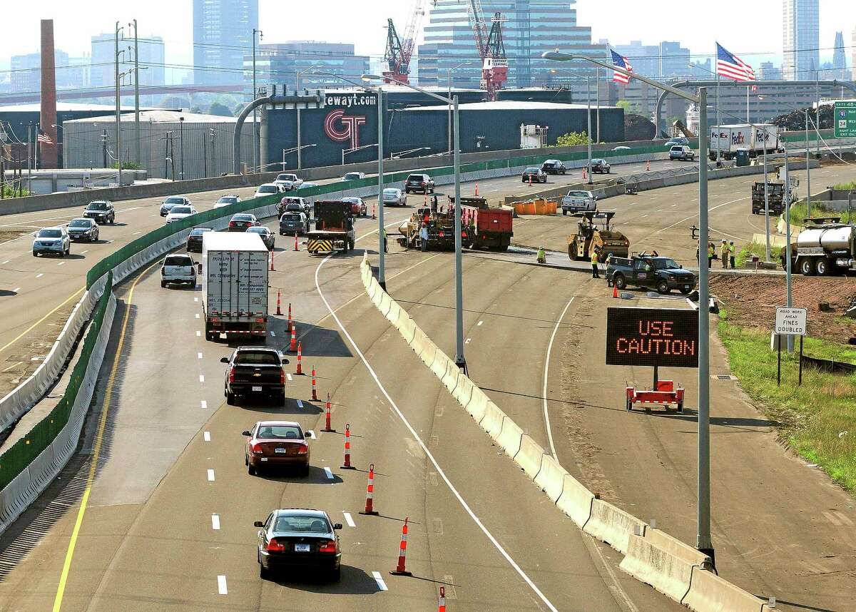 In this July 27, 2013, photo, traffic moves along southbound Interstate 95 in New Haven after the traffic pattern was diverted from the old Pearl Harbor Memorial Bridge approach, right, to the new span.