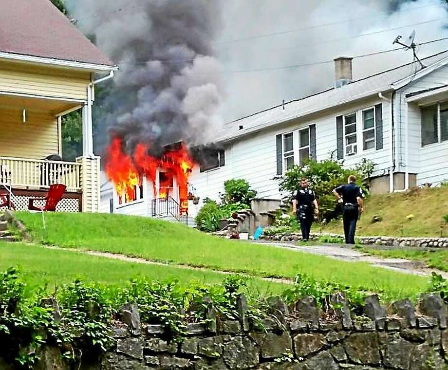 A man, 50, was found dead Tuesday night after a fire broke out on Colony Street in Ansonia. The cause of the fire and the man's death remained under investigation Wednesday. Photo: (Photo Via The Ansonia Fire Department)