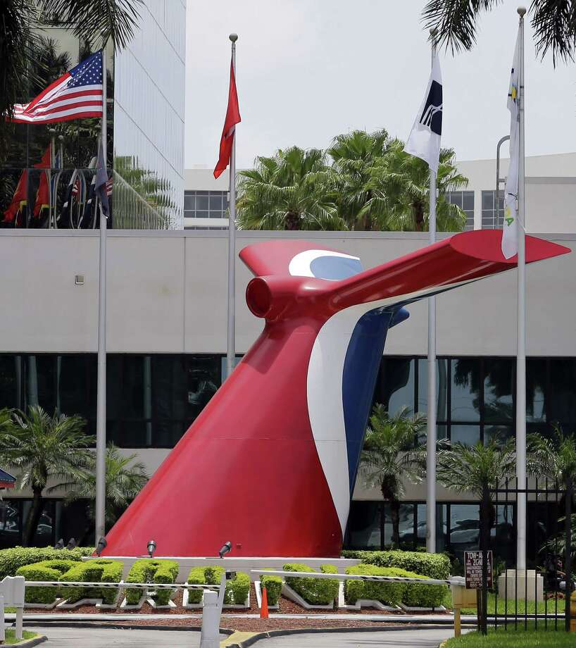 Carnival Cruise Lines main entrance of their office building is shown, Tuesday, July 7, 2015, in Miami. Starting in May, Carnival Corp. plans to offer trips from Miami to Cuba, the company announced Tuesday. Carnival says it would become the first American cruise company to visit the Caribbean island nation since the 1960 trade embargo. (AP Photo/Alan Diaz) Photo: AP / AP