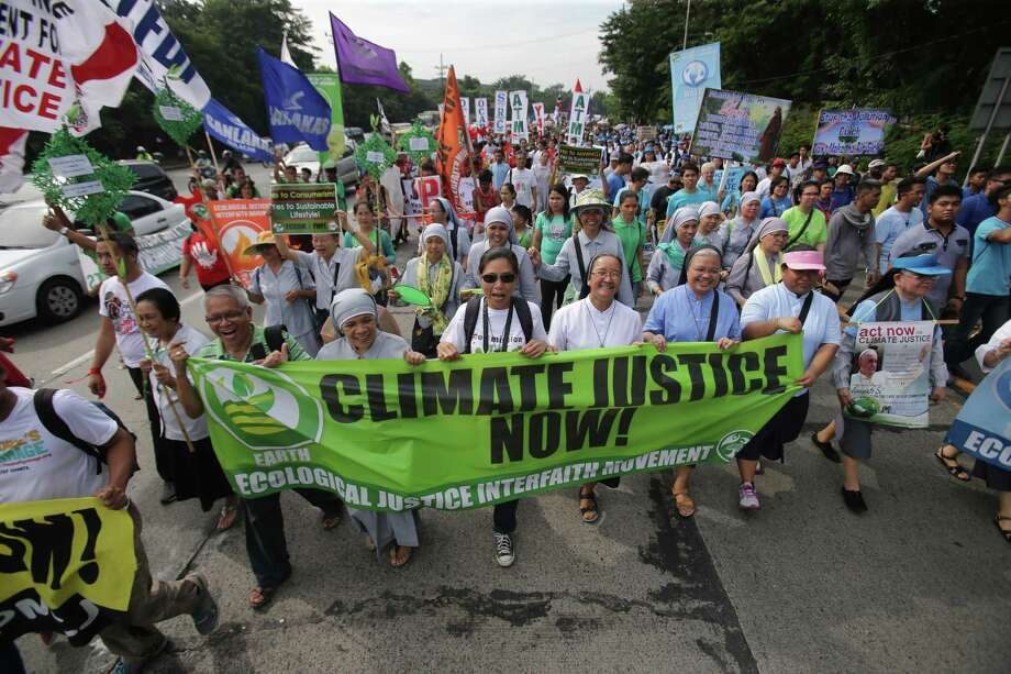 Filipino nuns and priests, along with Catholic groups, lead a march to raise awareness on the dangers of climate change in suburban Quezon city, north of Manila, Philippines. Photo: AP Photo   / AP