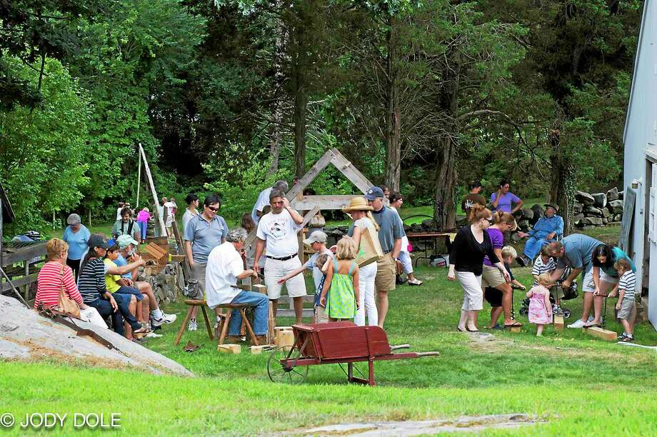 Demonstrators at Bushnell Farm's event last year assist visitors in hands-on activities. Photo: Contributed