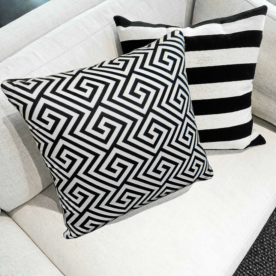 Black and white M Cushions on a sofa Photo: Contributed   / @ GoodMoodPhoto
