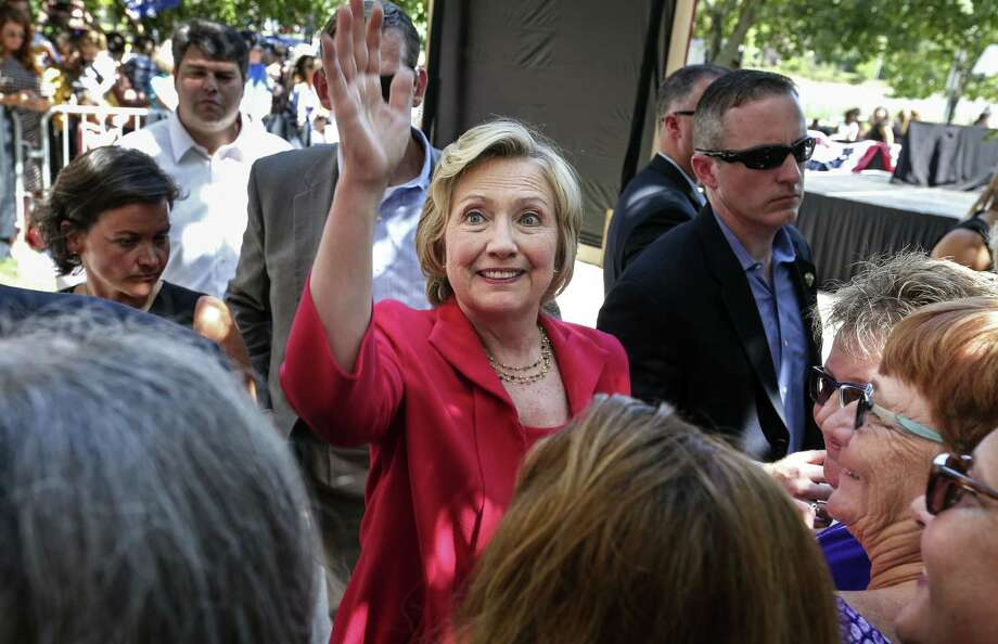 Democratic presidential candidate Hillary Rodham Clinton waves as she leaves after being endorsed by Sen. Jeanne Shaheen, D-N.H., during the kick-off event for New Hampshire Women for Hillary in Portsmouth, N.H.,  Saturday, Sept. 5, 2015. Photo: (AP Photo/Cheryl Senter) / FR62846 AP