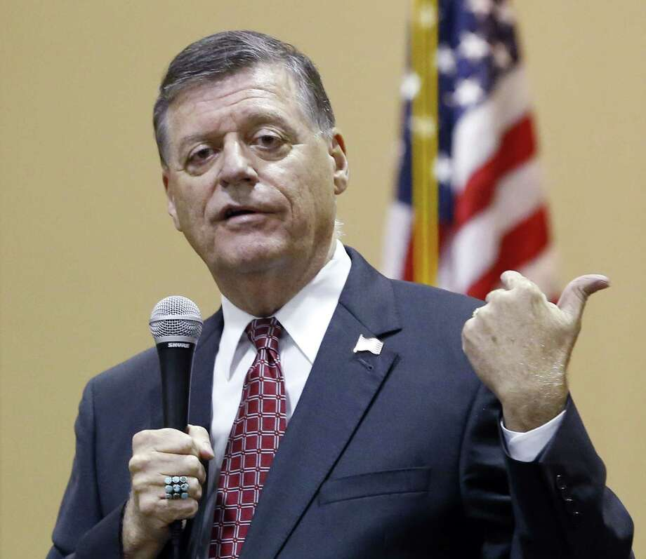 """FILE - In this Aug. 18, 2015, photo, Rep. Tom Cole, R-Okla., gestures as he speaks during a town hall meeting in Moore, Okla. Congress returns on Sept. 8 with a critical need for a characteristic that has been rare through a contentious spring and summer _ cooperation between Republicans and President Barack Obama. """"It's going to take a sense of give and take on both sides,"""" said Cole. """":The big deal will be, ëCan you come to a deal on transportation, debt ceiling and avoiding sequester?"""" So a large budget deal will determine, I think, whether or not we've really been successful."""" Photo: (AP Photo/Sue Ogrocki, File) / AP"""
