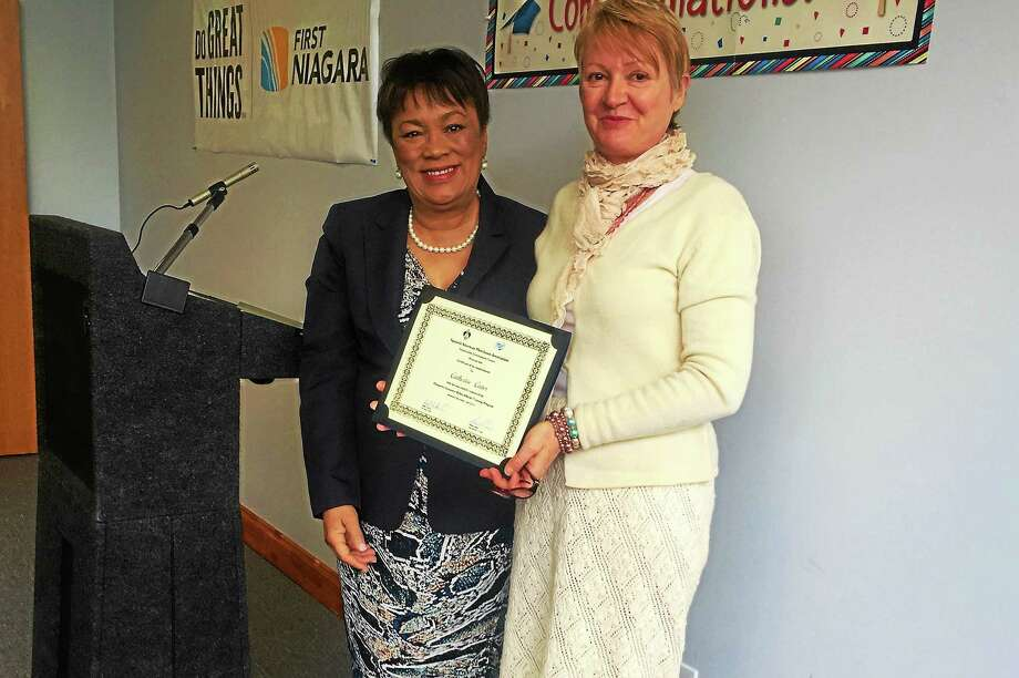 New Haven Mayor Toni Harp, left, poses with SAMA graduate Catherine Cazes Thursday in New Haven. Photo: Esteban L. Hernandez — New Haven Register