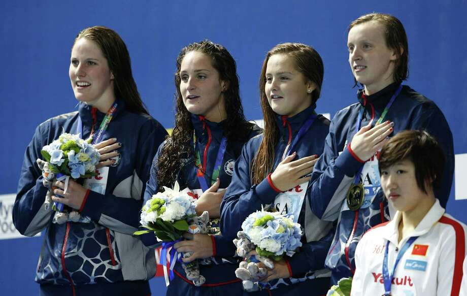 United States gold medal winners, from left, Missy Franklin, Leah Smith, Katie McLaughlin and Katie Ledecky listen to the national anthem on Thursday during the ceremony for the women's 4x200m freestyle relay final at the Swimming World Championships in Kazan, Russia. Photo: Sergei Grits — The Associated Press   / AP