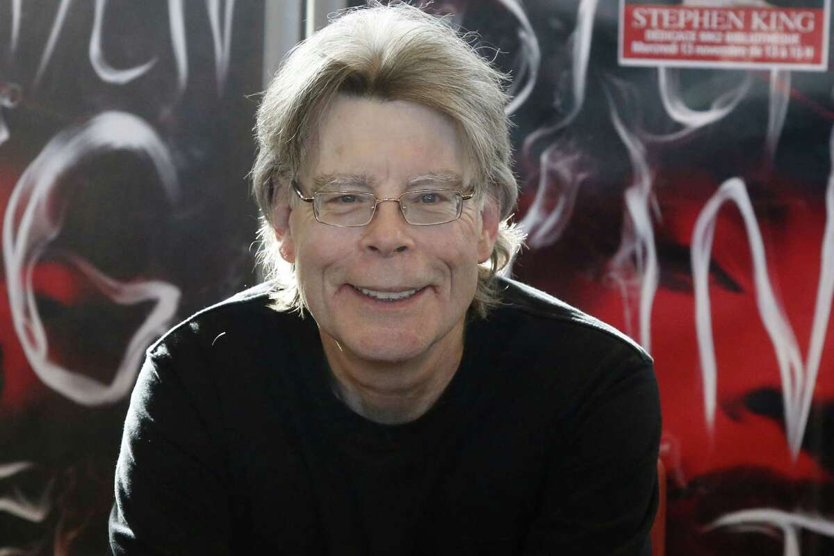 In this Nov. 13, 2013 file photo, author Stephen King poses for the cameras, during a promotional tour for his latest novel, 'Doctor Sleep', a sequel to 'The Shining', in Paris. King is one of several artists who will receive the National Medal of Arts from President Barack Obama at a White House ceremony. The president and first lady Michelle Obama will present the award Sept. 10, 2015 to King and 11 others.
