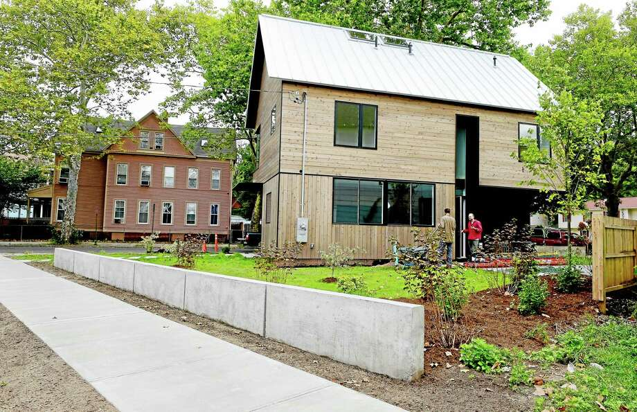 First-year Yale School of Architecture students designed and built a new home as part of the Jim Vlock First Year Buildling Project at 193 Winthrop Ave. in New Haven. Photo: Peter Hvizdak — New Haven Register   / ©2015 Peter Hvizdak