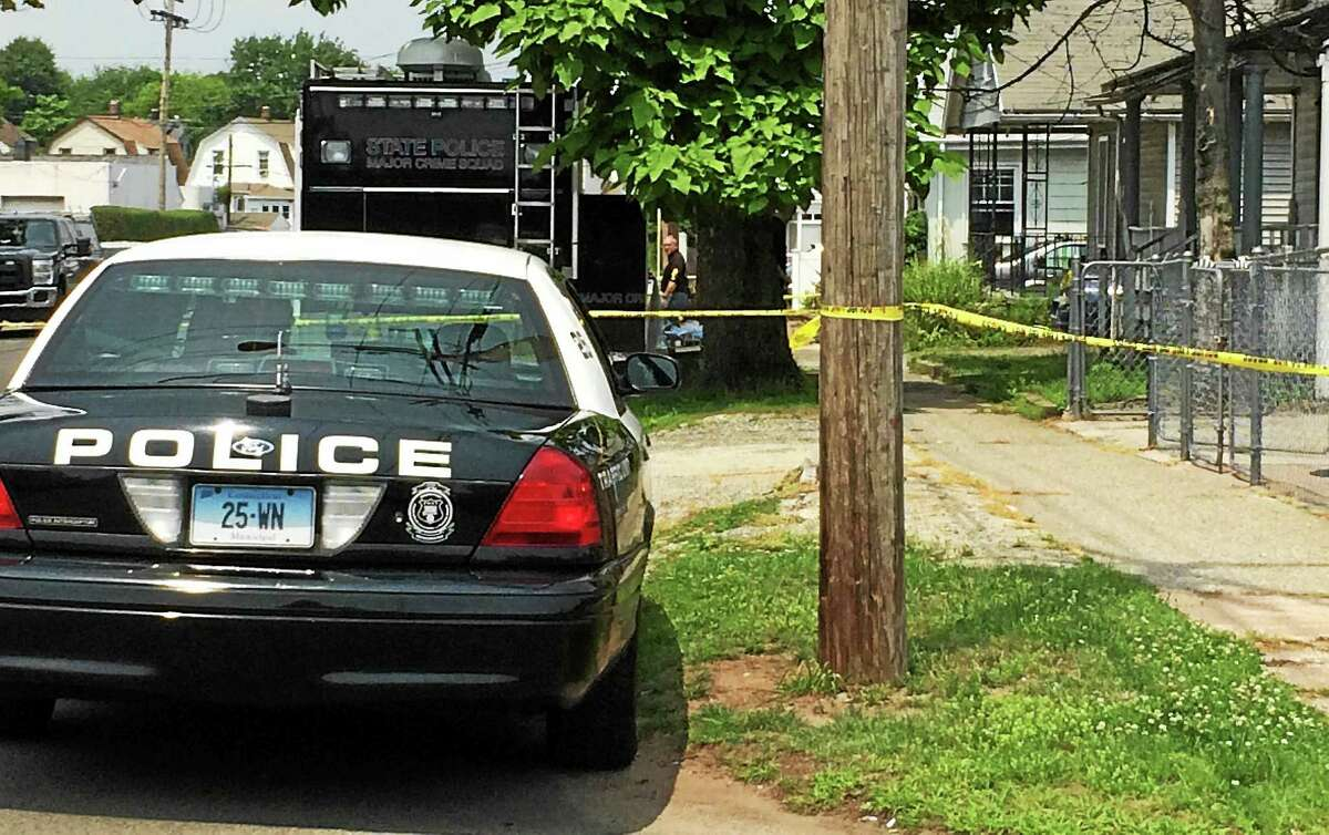 Wes Duplantier -- New Haven Register Police searched a home Monday at 59 Front Ave. in West Haven as they investigate the death of Edward Brooks, 39, whose body was found in Hamden over the weekend.