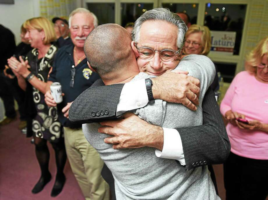 Campaign manager Joseph Zullo (back to camera) celebrates with East Haven Mayor Joseph Maturo Jr. after election results are announced at campaign headquarters in East Haven Tuesday night. Photo: Arnold Gold — New Haven Register