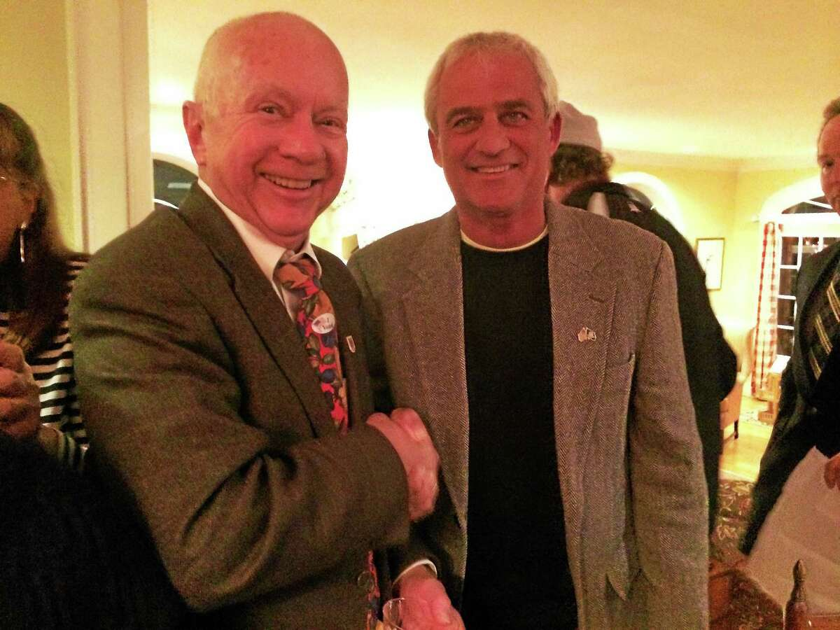 Outgoing First Selectman Fillmore McPherson, left, with Tom Banisch Tuesday night.