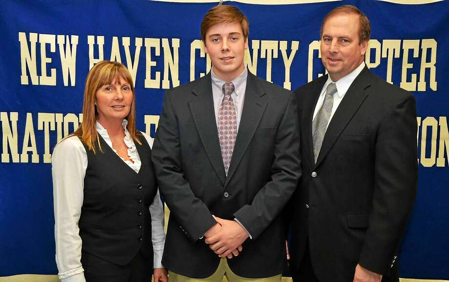 Sean Marinan, center, played for his father at Xavier High and his mother loves UConn. Add it all up and the junior walk-on is now making an immediate impact with the Huskies. Photo: Register File Photo