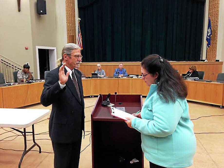 Myron Hul is sworn-in Monday night as the 6th District councilman, replacing Tom Rousseau, who moved to New Hampshire. Photo: Kate Ramunni — New Haven Register
