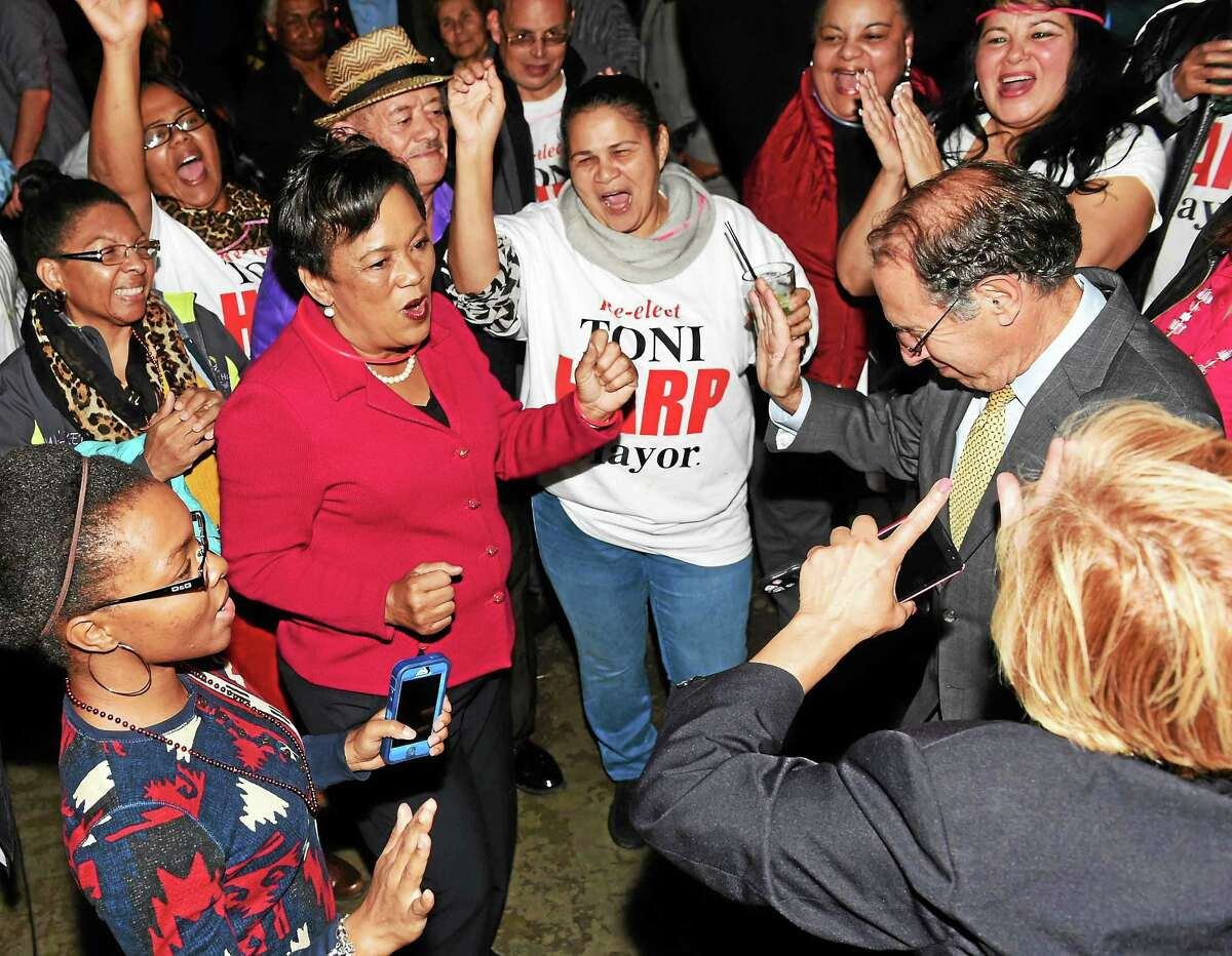 New Haven Mayor Toni Harp dances with her supporters as she celebrates her Election Day win and second term with a party at the Keys to the City piano bar on Long Wharf Drive in New Haven Tuesday night.