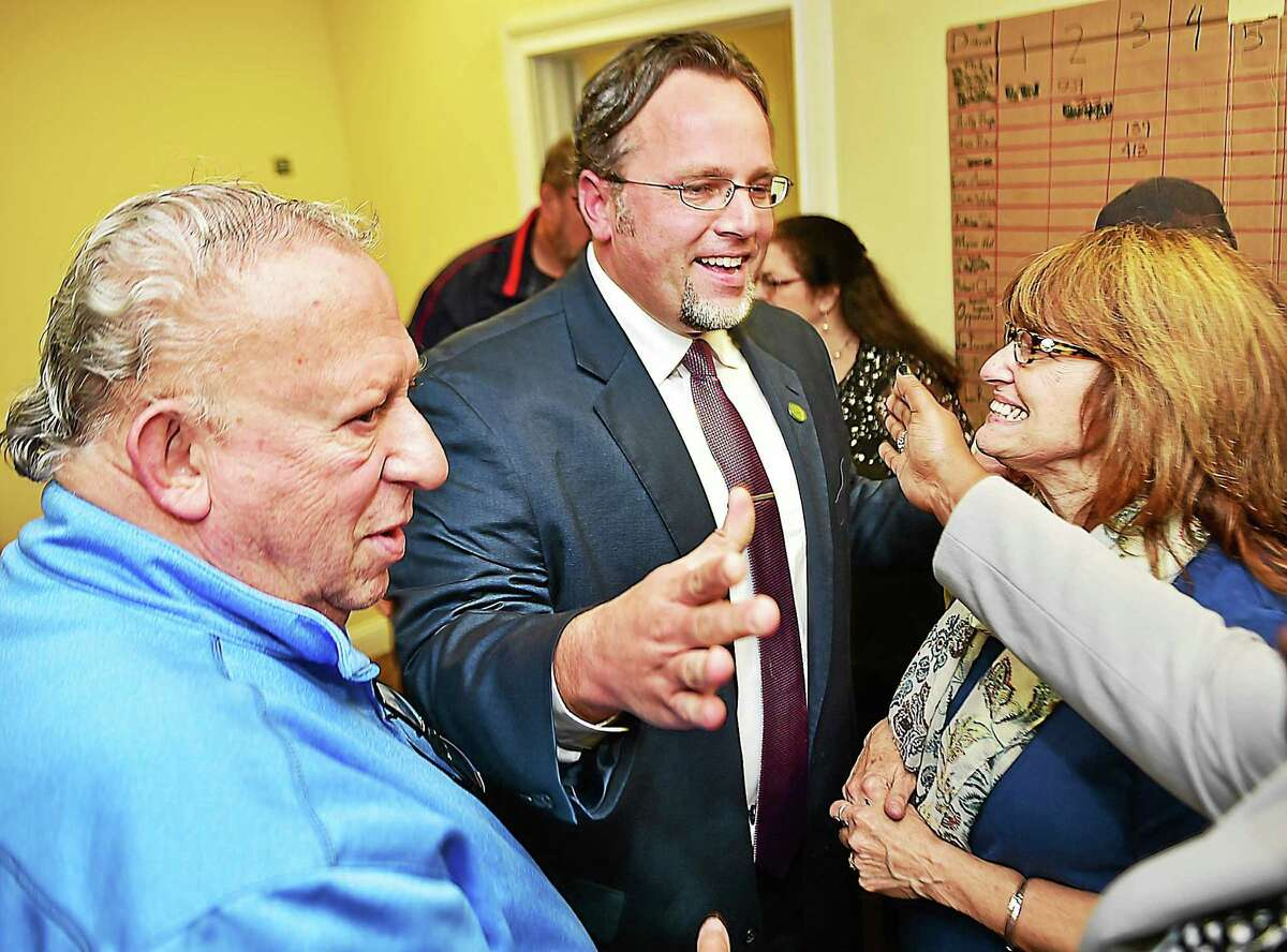 Mayor Curt Balzano Leng celebrates with Elliot Kerzner, left, and his mother, Linda Leng, right, after defeating Republican Bob Anthony Tuesday.