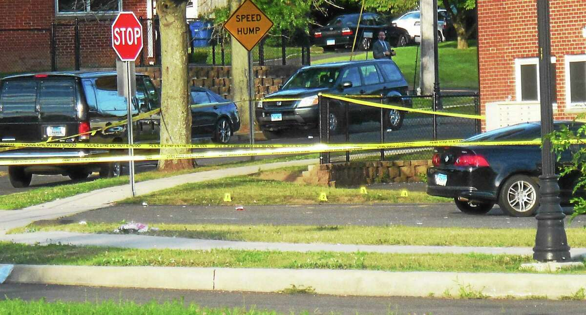 At least four evidence markers could be seen Thursday morning in a grassy area along Bouchet Lane where police were investigating the city's latest homicide. Police are asking for the public to help them find out more about what occurred.