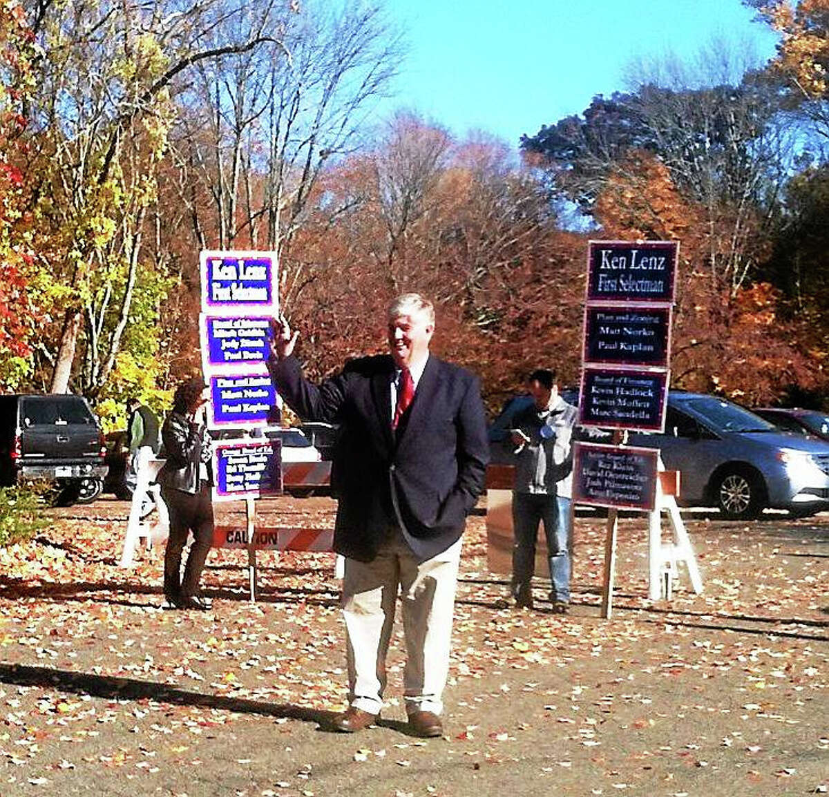 Orange First Selectman James Zeoli greets voters outside the polls Tuesday at Mary L. Tracy School.