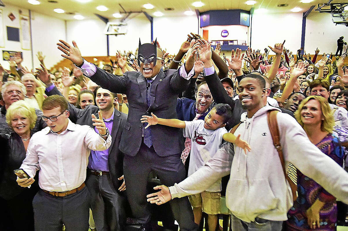 """Daymond John of ABC's reality business show, """"Shark Tank,"""" takes one of his infamous crowd shots with Brian Johnson, 7, of Meriden Tuesday at the Burt Kahn Court at Quinnipiac University in Hamden."""