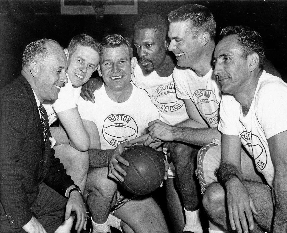 Coach Red Auerbach, left, huddles with, from left, Frank Ramsey, Jim Loscutoff, Bill Russell, Tom Heinsohn and Bob Cousy.